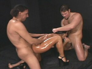 Nasty oiled brunette slut double fucked hard