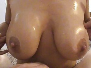 Busty amateur girlfriend gives titjob with cumshot