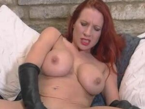 Busty red head gets wet and sticky in sexy leather gloves