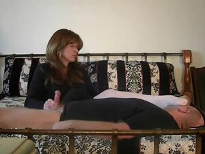 Domineering mistress jerks off a man in an unusual way