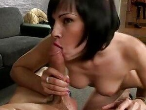 Short haired bitch sucks big white cock on her knees