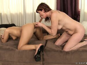 Old lezzo and her young kitty friend really love their huge double dildo