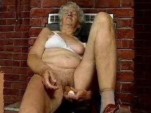 Hairy cunt granny masturbates with toys