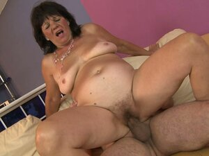 This nasty granny rides this dick up her hairy snatch