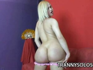Sexy blonde shemale cums on herself