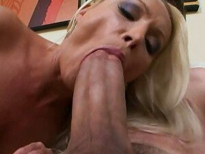 Slutty blonde babe takes on a huge dick and sucks it