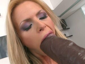 Skanky blond mom gives blowjob to huge brown dildo
