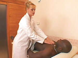 Blonde sexy masseuse has fun with a black stud. Hot video