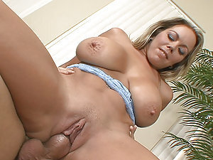 Amber Lynn Bachs huge boobs bounce as she rides hard on huge cock