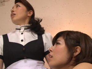 A pair of sexy Asian maids are forced to fuck each other
