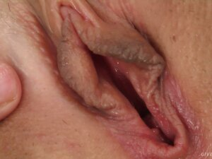 Adrienne spreads pussy lips and sticks in a giant dildo to fuck herself
