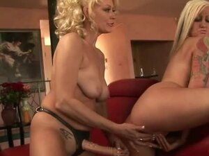 Long strapon dildo slides into blonde pussy