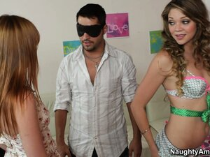 Jessie Andrews and her friend blindfold this guy and start slurping on his sausage