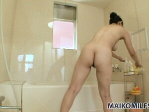 In the shower, a hot Asian lady displays her big boobs, sexy ass and her love for cock