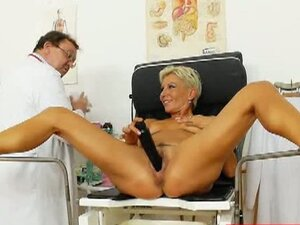 Granny lets mature doctor gape her pussy