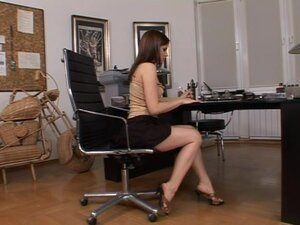 Lustful girl has some fun in the office toying her ass