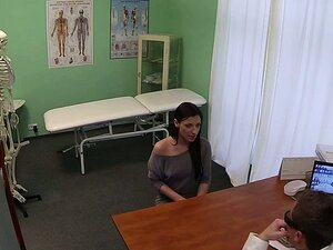 Brunette rubs pussy with massage tool at her doctor