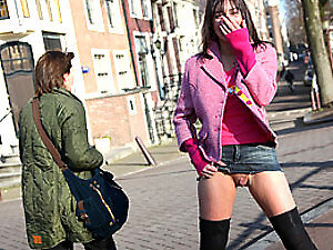 Hot cutie exposing her teenage snatch on a public street