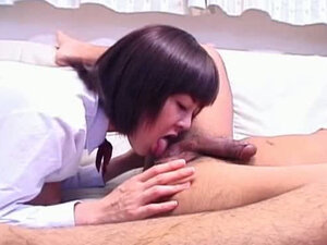 Young brunette Japanese whore gives rimjob and titjob