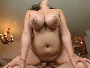 Busty chubby rides a hard cock