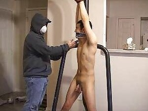 Tied up stud gets his cock stroked