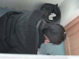 Crouching toilette black hair woman wiping her ass after taking a shit