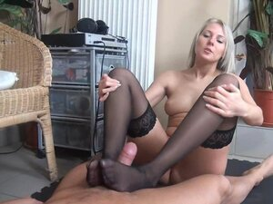 This petite blonde dominatrix uses her slaves foot fetish to drive him wild with lust, giving him a world class footjob Watch her make his cock jump with pleasure using her feet