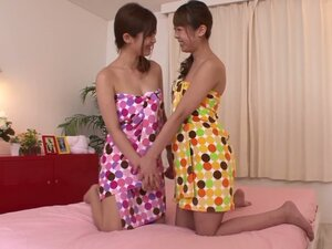 Two sweet Japanese lesbians toy each others pussies