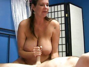 Slow handy from a big titty mature brunette