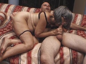 Hot granny is giving a deep sloppy blowjob