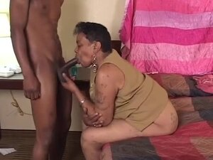Ebony granny sucks a black cock before taking it in her old pussy