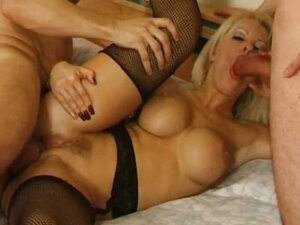Huge breasted blonde whore in stockings gets fucked by two hunks