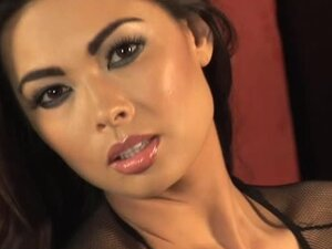 Busty brunette Tera Patrick strokes her gorgeous body seductively