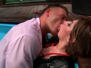 Couple in the pool kisses erotically