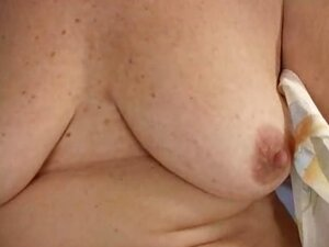 Nasty granny Lady stripping panties and playing with her hairy pussy on the couch