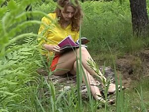Magazine reading teen pees outdoors
