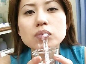 Lusty Asian chickj drinks jizz from a glass