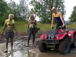 Sexy girls get muddy outdoors