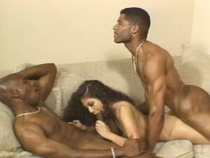 Curly haired doll is having interracial fuck