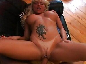 Heavy chested blonde with tattoo and pierced twat gets drilled