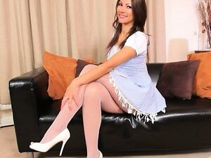 Pink pants and high heels on the sofa
