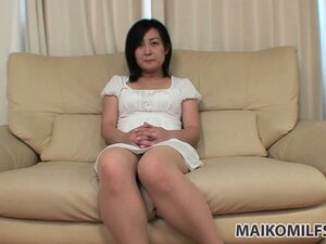 Lustful Asian milf drops her white dress and reveals her nice tits and her tight cunt