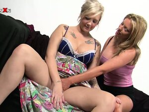 Sexy blonde Holly gently slides her fist deep in horny blonde Mandy's juicy twat